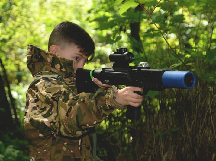 aiming a laser tag london weapon in the forest